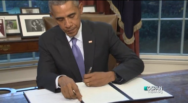 U.S. President Obama taking his veto pen to the original 2016 NDAA. Credit: C-SPAN