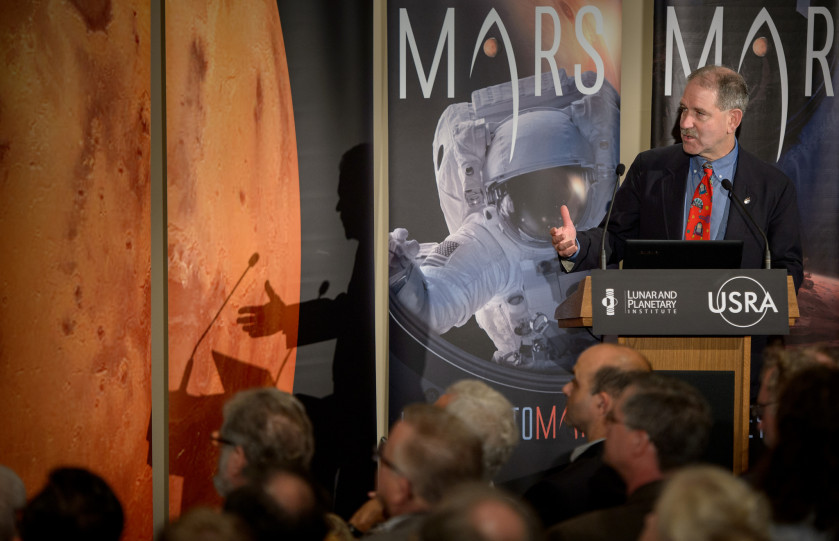 John Grunsfeld, NASA's associate administrator for science, speaks Oct. 27 during the First Landing Site/Exploration Zone Workshop for Human Missions to the Surface of Mars held at the Lunar and Planetary Institute in Houston. NASA hosted the workshop to collect proposals for locations on Mars that would be of high scientific research value while also providing natural resources to enable human explorers to land, live and work safely on the Red Planet. Credit: NASA/Bill Ingalls