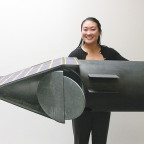Microcosm's Lynn Shimohara with a full-scale model of the all-composite, hydrazine-fueled NanoEye small spacecraft. Credit: Microcosm