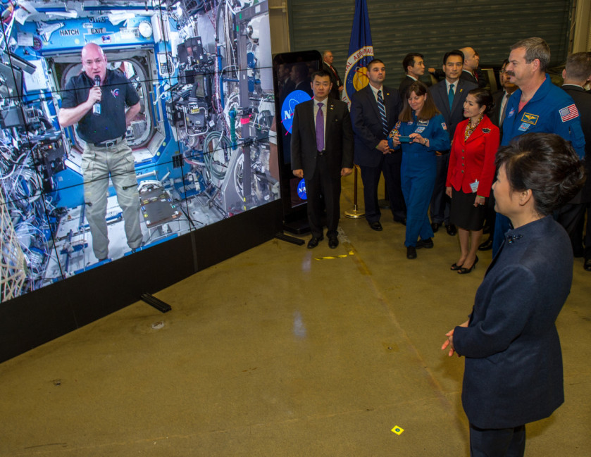 South Korean President Park watches a message sent down from Astronaut Scott Kelly aboard the International Space Station. Kelly who is a little more than halfway thru a year-long stay on ISS welcomed Madam Park to NASA Goddard. Credit: NASA/Goddard/Bill Hrybyk