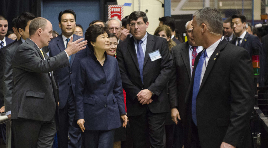 South Korean President Park Geun-hye and Goddard Space Flight Center Director Christopher Scolese are greeted by Frank Cepollina, associate director of the Satellite Servicing Capabilities Office, and Benjamin Reed, deputy project manager of the Satellite Servicing Capabilities Office. Credit: NASA/Rebecca Roth