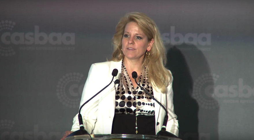 "SpaceX President Gwynne Shotwell, shown above speaking at CASBAA in 2013, said SpaceX doesn't ""have a lot of effort"" going into designing a 4,000-satellite broadband constellation Elon Musk announced in January. Credit: CASBAA video"