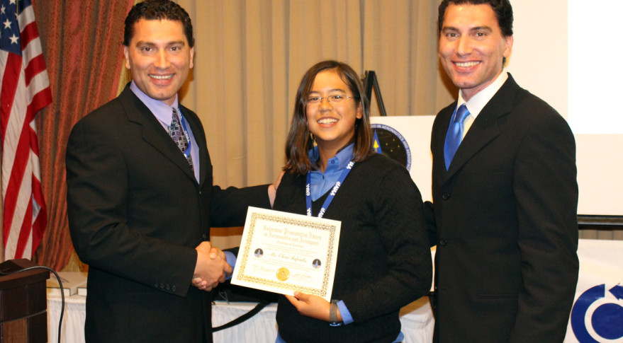 Amir and Omid Gohardani present the first Gohardani Presentation Award in Aeronautics and Aerospace to student Eleni Fafoutis. Credit: AIAA
