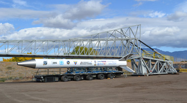 The rail launcher to be used in Hawai'i's first space launch was unveiled in October 2013 in Albuquerque, New Mexico. Attached to the rail launcher is a scale model of the Super Strypi rocket. Credit: University of Hawaii/Sandia National Laboratories