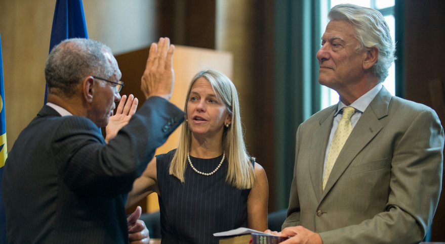NASA Administrator Charlie Bolden ceremonially swore in Dava Newman on July 14 as her husband, Guillermo Trotti, holds the Bible. Credit: NASA/Joel Kowsky