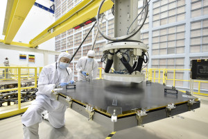 Engineers at NASA's Goddard Space Flight Center in Greenbelt, Maryland, install the first of 18 segments that make up the James Webb Space Telescope's 6.5 meter primary mirror. Credit: NASA/Chris Gunn