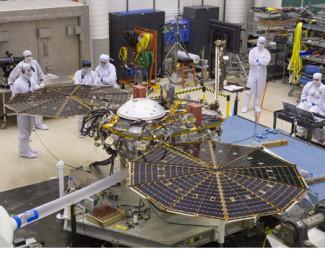 InSight Mars lander undergoing a solar array deployment test in the MTF clean room at Lockheed Martin. Credit: Lockheed Martin