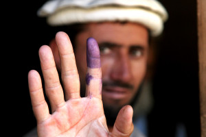 Globecomm helped build a communications network that was completed in time to support Afghanistan's 2004 election, which made purple-ink-stained fingers a symbol for the blooming of democracy. Credit: Creative Commons