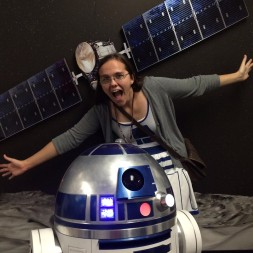 Keri Bean, still a fresh face at NASA's Jet Propulsion Laboratory, realy likes robots. She helped build the R2-D2 in the foreground, and she helps operate the real-life NASA Dawn spacecraft in the background. Credit: Keri Bean