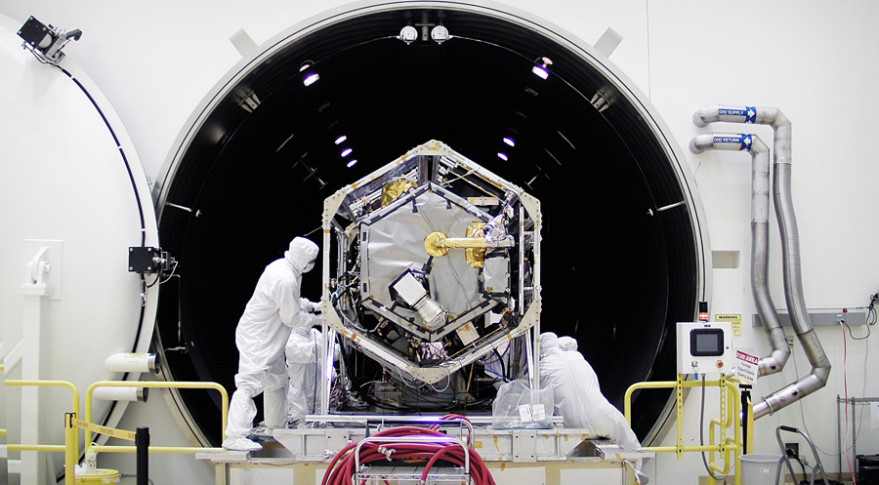 NASA once again plans to track carbon dioxide from the ISS using an instrument left over from the campaign to build the Orbiting Carbon Observatory-2, shown above entering a thermal vacuum chamber at Orbital ATK's Gilbert, Arizona, spacecraft factory prior to the satellite's 2014 launch.  Credit: NASA