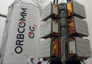 Eleven Orbcomm spacecraft are attached to their dispenser prior to being encapsulated within the Falcon 9's payload fairing. Credit: Orbcomm