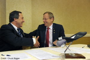 Sierra Nevada's Mark Sirangelo and Johann-Dietrich Woerner, then head of Germany's DLR, sign an April 2015 memorandum of understanding on Dream Chaser cooperation. Woerner now heads ESA, which is investing in Dream Chaser. Credit: SNC Corp.
