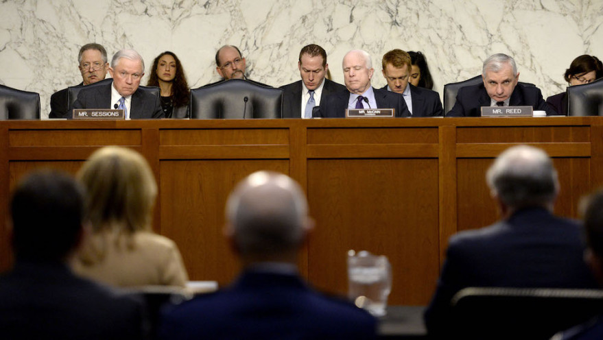Senate Armed Services Committee Chairman John McCain (R-Ariz), center, said he intends to introduce legislation that would reinstate the National Defense Authorization Act of 2016's RD-180 engine ban. Credit: U.S. Air Force photo/Scott M. Ash
