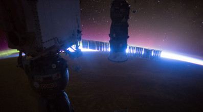 Sunrise as viewed from the International Space Station in November. Framing the edge of sun is the Soyuz TMA-17M (front) which brought NASA astronaut Kjell Lindgren, JAXA astronaut Kimiya Yui and Russian cosmonaut Oleg Kononenko to the station and a Russian Progress 60 (back) cargo craft which arrived back in July. Credit: NASA JSC
