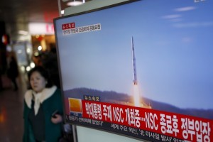 A passenger walks past a TV screen broadcasting a news report on North Korea's long range rocket launch at a railway station in Seoul, South Korea, February 7, 2016.   Credit: REUTERS/Kim Hong-Ji