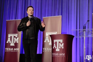 "SpaceX Chief Executive Elon Musk, speaking  Jan. 30 at a hyperloop design competition at Texas A&M, said he expected the first Falcon Heavy flight ""toward the end of the year... maybe late summer."" Credit: Texas A&M/Facebook"