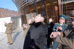 North Korean leader Kim Jong Un watches a long range rocket launch into the air in North Korea, in this photo released Feb. 7 by Kyodo.   Credit: REUTERS/Kyodo