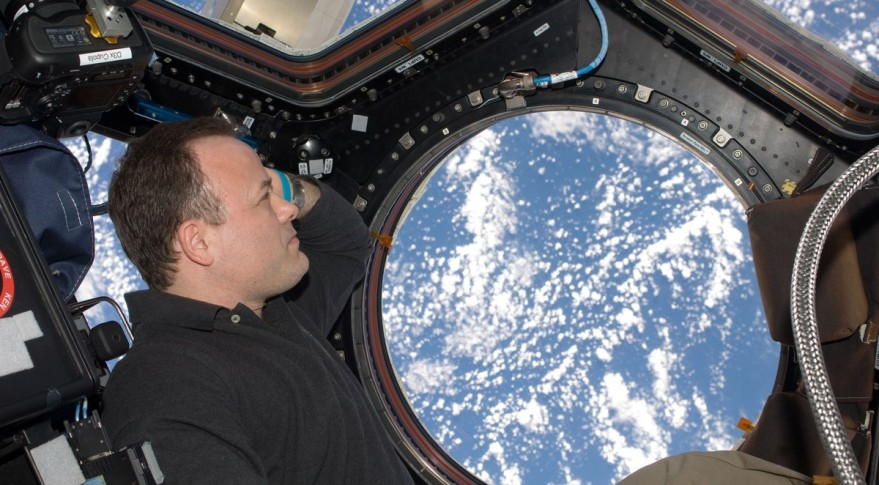 Former NASA astronaut Ron Garan, seen here looking out the window at the International Space Station in 2011, will provide World View customers with their own views of the Earth piloting the company's high-altitude balloons. Credit: NASA