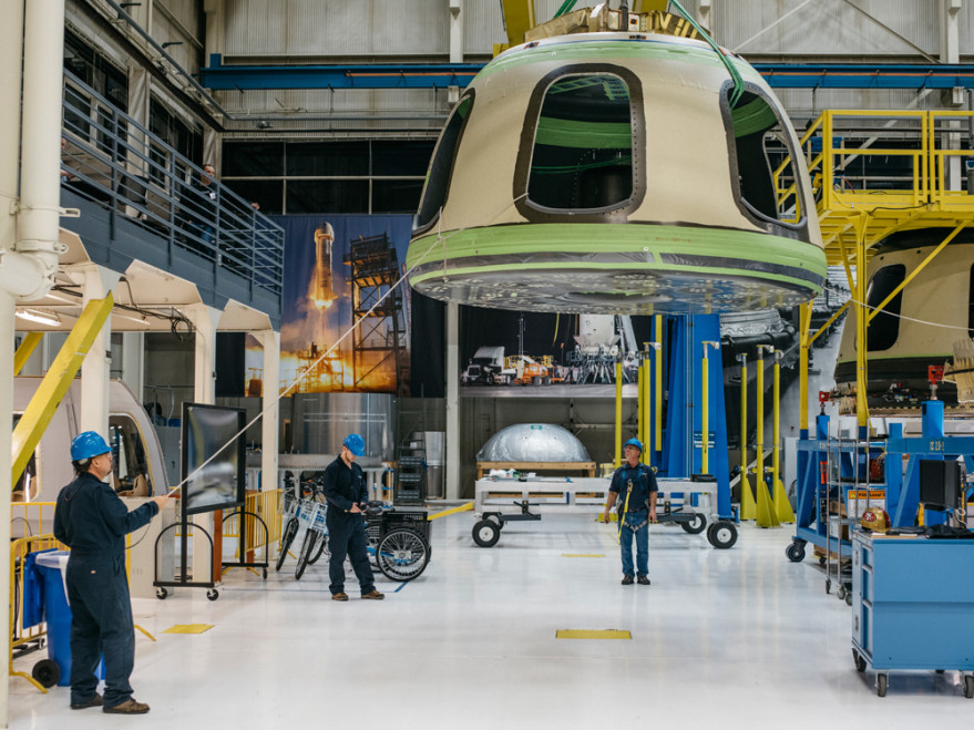 Blue Origin workers move a spacecraft component at the company's Kent, Washington, factory. Credit: Blue Origin