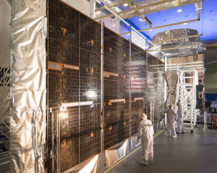 The MUOS 5 satellite undergoing pre-launch inspection. Credit: Lockheed Martin.