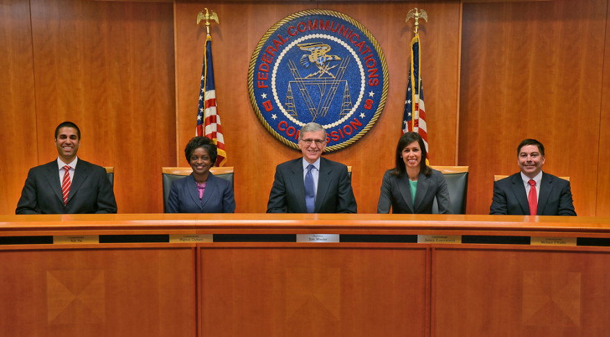 U.S. Federal Communications Commission Chairman Tom Wheeler, center, ripped into the satellite industry for what he called self-defeating intransigence over sharing of Ka-band spectrum. Credit: FCC