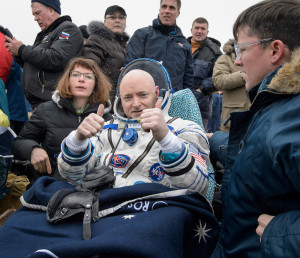 NASA astronaut Scott Kelly rests in a chair outside of the Soyuz TMA-18M spacecraft just minutes after he and Russian cosmonauts Mikhail Kornienko and Sergey Volkov of Roscosmos landed in Kazakhstan on March 2.