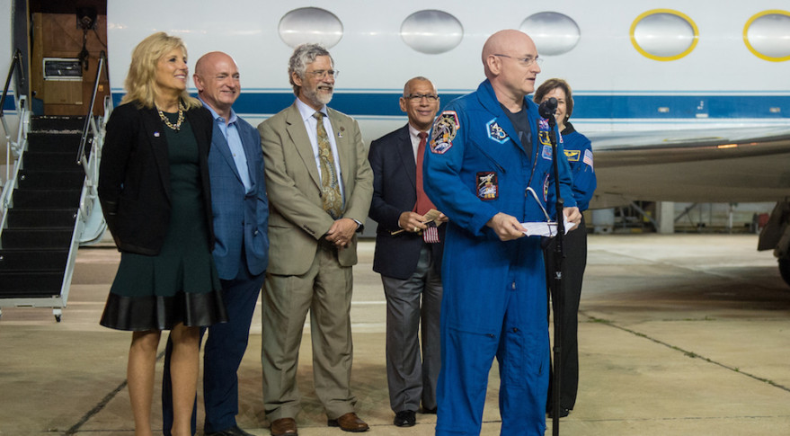 NASA astronaut Scott Kelly speaks after coming home to Houston March 3, 2016. Behind Kelly, from left to right:  Jill Biden, wife of U.S. Vice President Joe Biden; Kelly's identical twin brother, Mark; White House Science Adviser John Holdren; NASA Administrator Charles Bolden; and former astronaut Ellen Ochoa, director of NASA's Johnson Space Center. Credit: NASA/Joel Kowsky