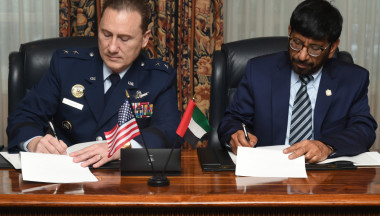 """U.S. Air Force Maj. Gen. Clinton Crosier, U.S. Strategic Command's director of plans and policy (left), and Khalifa Al Romaithi, United Arab Emirates Space Agency  chairman, sign a memorandum of understanding at the Broadmoor Hotel in Colorado Springs, Colorado on April 11. The MOU to share space situational awareness services and information """"will enhance awareness within the space domain and increase the safety of spaceflight operations for the U.S. and UAE,"""" according to U.S. Strategic Command.  Credit: U.S. Air Force/ Senior Airman William Branch"""