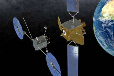 An Orbital ATK Mission Extension Vehicle (left) approaches a commercial communications satellite. Credit: Orbital ATK illustration.