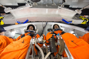 Engineers at NASA's Johnson Space Center are evaluating how crews inside a mockup of the Orion spacecraft interact with the rotational hand controller and cursor control device while inside their Modified Advanced Crew Escape spacesuits. Credit: NASA
