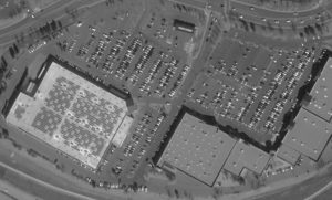 An example of imagery Orbital Insight processes for customers interested in counting cars in shopping center parking lots. Credit: DigitalGlobe and Airbus.
