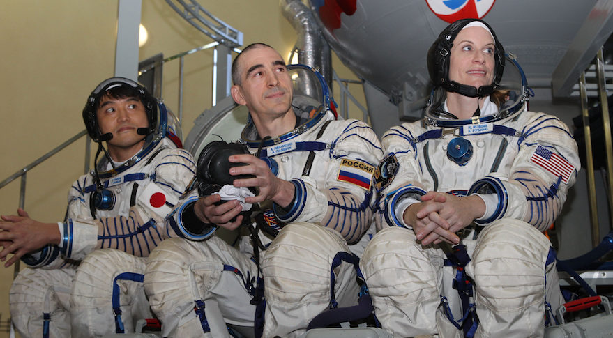 Expedition 48-49 prime crewmembers Takuya Onishi of the Japan Aerospace Exploration Agency (left), Anatoly Ivanishin of Roscosmos (center) and Kate Rubins of NASA (right) field questions from reporters May 27 at the Gagarin Cosmonaut Training Center in Star City, Russia. Rubins, Onishi and Ivanishin will launch July 7 on the Soyuz MS-01 spacecraft from the Baikonur Cosmodrome in Kazakhstan for a four-month mission on the International Space Station. Credit: NASA/Stephanie Stoll