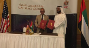 UAE Space Agency Chairman Khalifa Al Romaithi and NASA Administrator Charles Bolden pose Sunday with the agreement they signed at a meeting in Abu Dhabi. Credit: UAE Space Agency