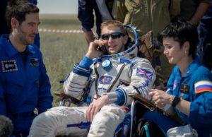Tim Peake of the European Space Agency talks on a satellite phone in a chair outside the Soyuz TMA-19M spacecraft just minutes after he and Yuri Malenchenko of Roscosmos and Tim Kopra of NASA landed in a remote area near the town of Zhezkazgan, Kazakhstan on June 18. Kopra, Peake, and Malenchenko are returning after six months in space where they served as members of the Expedition 46 and 47 crews onboard the International Space Station. Credit: NASA/Bill Ingalls