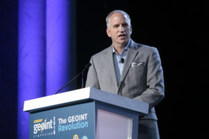 Robert Cardillo, the director of the National Geospatial-Intelligence Agency, speaks at the GEOINT 2016 conference in Orlando. The NGA announced a new collaboration to help buy and analyze commercial satellite imagery. Credit: USGIF.