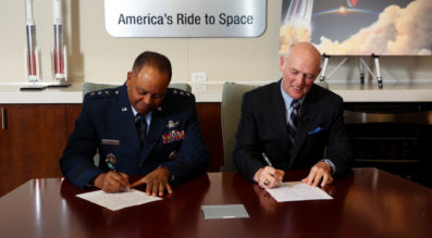 Lt. Gen. Samuel Greaves, Air Force program executive officer for Space and SMC commander, and Tory Bruno, ULA president and CEO, sign a Cooperative Research and Development Agreement or CRADA for the certification of ULA's Vulcan Launch System at a ceremony, Sept. 27. Credit: ULA