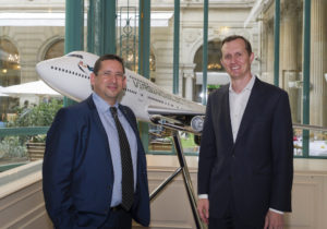 Meir Moalem, CEO and Founder of Sky and Space Global and George Whitesides, CEO of Virgin Galactic pose in front of a LauncherOne model at the World Satellite Business Week Conference in Paris. Credit: Virgin Galactic