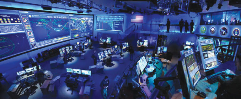 "Applied Minds, Inc. created a vision of how to achieve optimal SSA through the "" JSpOC of the Future"" demonstration at their Glendale, California, facility. The company designed and built a fullscale, multi-faceted command center mockup that demonstrated advanced tools and techniques for distributed collaboration, data fusion, visualization, and adaptive planning. Credit: U.S. Air Force Research Lab"