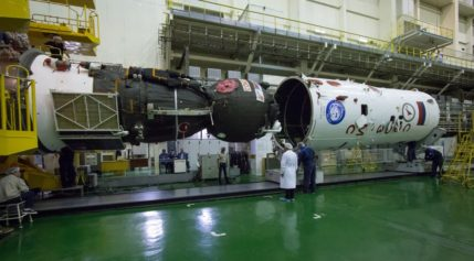 The Soyuz MS-02 spacecraft being prepared for launch in September. A problem with the spacecraft found only after it was placed inside its payload fairing has delayed its launch until the end of October. Credit: NASA/Victor Zelentsov