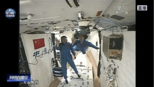 Chinese astronauts Jing Haipeng and Chen Dong enter the Tiangong 2 module Oct. 18. Credit: CCTV video still