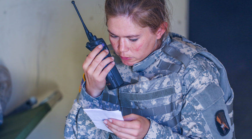 U.S. Army Sgt. Samantha Dubuis, Senior Satcom communication systems operator, 578th Signal Company, Fort Bragg, N.C., makes a radio call during a Best Warrior Competition at Fort Huachuca, Ariz., June 10, 2014. Credit: Spc. Lakendra Stevens/US Army