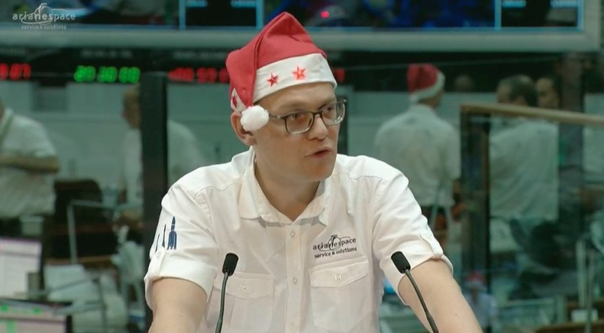 Arianespace Chief Executive Stephane Israel gets into the holiday spirit following the successful Dec. 21 launch of an Ariane 5 carrying satellites for Embratel Star One and Sky Perfect JSAT. Credit: video still of Arianespace launch broadcast