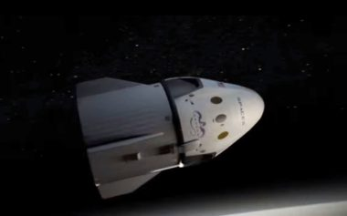 A SpaceX artist's concept of a Dragon capsule equipped with a  service module for a crewed flight around the moon in 2018. Credit: SpaceX