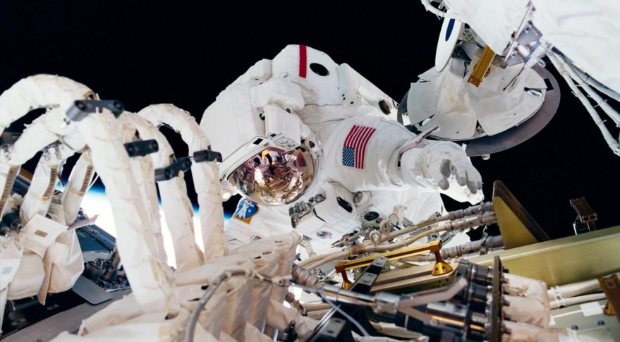 Astronaut Thomas D. Jones, mission specialist, works near the International Space Station during STS-98 in this 2001 file photo. NASA hopes a competition will help it improve waste disposal systems in spacesuits, either for long spacewalks or emergencies. Credit: NASA
