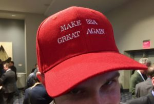 "ExoAnayltic Solutions VP and CIO Taylor Mitchell wearing a ""Make SSA Great Again"" hat at Satellite 2017's opening reception. Credit: SpaceNews"