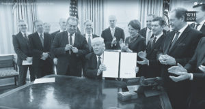 U.S. President Donald Trump signed an executive order Jan. 30 to reduce federal regulations. Lockheed Martin CEO Marillyn Hewson (to the right of Trump) was among the corporate executives in attendance. Credit: White House