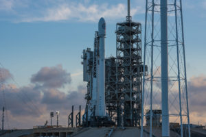 A SpaceX Falcon 9 rocket launched the NROL-76 payload for the NRO - sits on the launch pad April 29 at Launch Complex 39A. The rocket will have to wait at least 24 hours for liftoff after SpaceX scrubbed the launch planned for April 30 due to an issue with a first-stage sensor. Credit: SpaceX