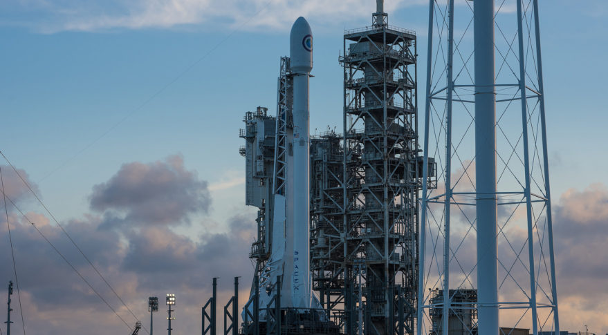 A SpaceX Falcon 9 rocket - carrying the NROL-76 payload for the NRO - sits on the launch pad April 29 at Launch Complex 39A. The rocket will have to wait at least 24 hours for liftoff after SpaceX scrubbed the launch planned for April 30 due to an issue with a first-stage sensor. Credit: SpaceX