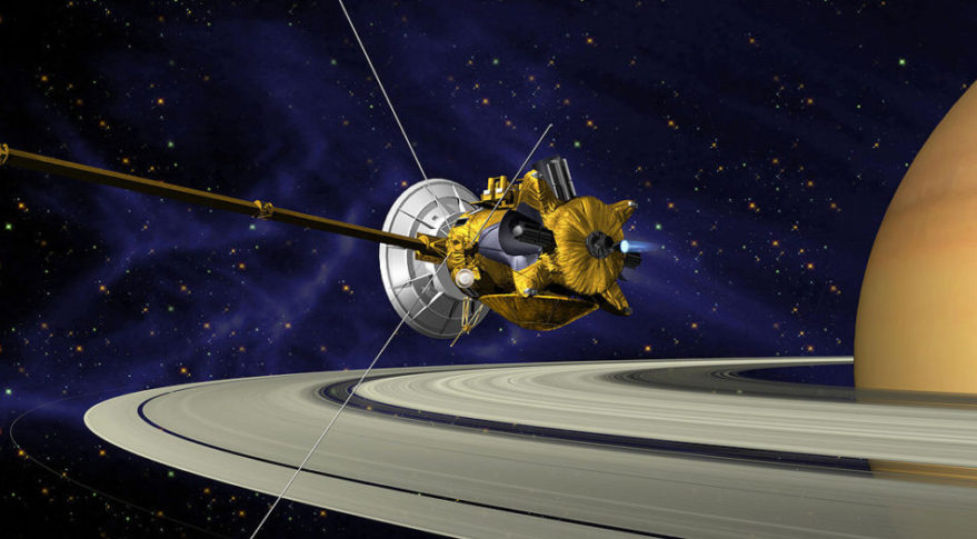 An illustration of NASA's Cassini spacecraft flying by Saturn. Credit: NASA/JPL-Caltech
