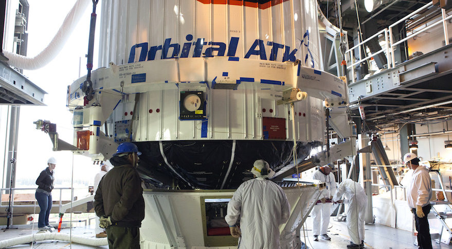 ULA technicians monitor the progress as the payload fairing containing the Orbital ATK Cygnus pressurized cargo module is lowered onto the Centaur upper stage of the Atlas 5 rocket scheduled to launch Cygnus to the ISS on April 18. Credit: ULA